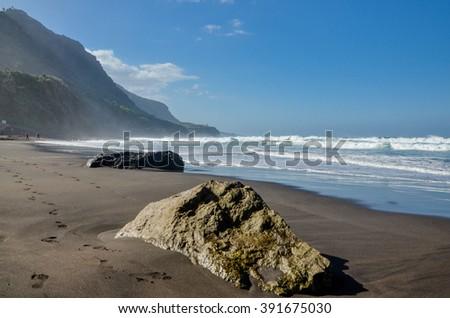 rocks and ocean waves on Playa El Socorro beach Los Realejos, Puerto de la Cruz, Tenerife, Canary Islands, Spain - stock photo