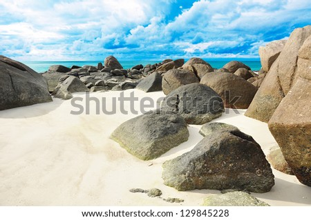 Rocks and sand on the seashore - Lipe island Thailand - stock photo