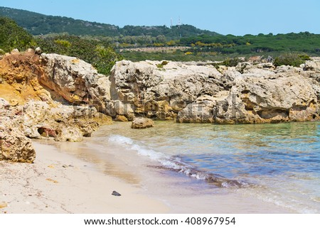 rocks and sea in a small cove in Sardinia - stock photo