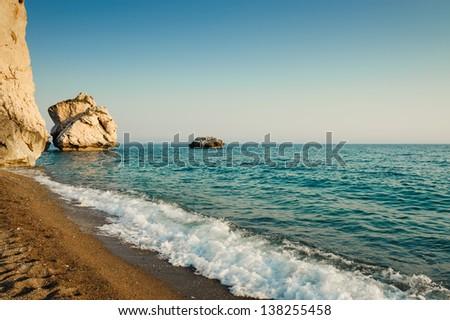Rocks and the sea (Petra tou Romiu, Cyprus) - stock photo