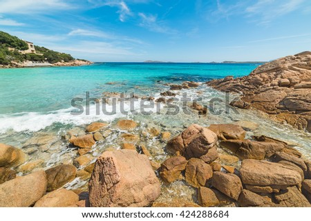 rocks and turquoise water in Capriccioli beach, Sardinia - stock photo