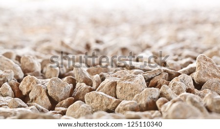 Rocks background to be used in composites. These are crude stones in the nature. - stock photo