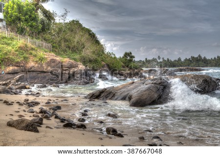 rocks  bathed by the Indian Ocean of the tropical island of Sri Lanka - stock photo