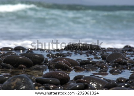 Rocks bathed in sea water - stock photo