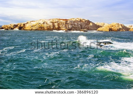 Rocks coast of Norway on a windy day - stock photo