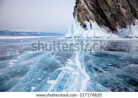 Rocks frozen into the ice of siberian Baikal Lake in winter - stock photo