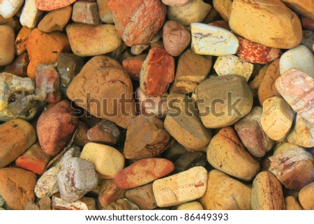 Rocks in a shallow pond - stock photo