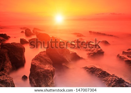 Rocks in Adriatic sea at sunset on the island of Brac, Croatia - stock photo