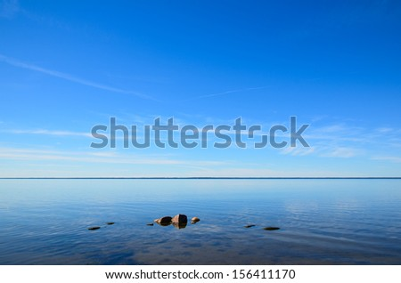Rocks in calm water at the coast of the Baltic sea in Sweden.
