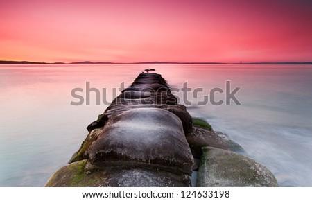 rocks in sea long exposure - stock photo