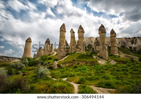 Rocks in the form of huge phalli in the valley of Love, Cappadocia, Turkey - stock photo