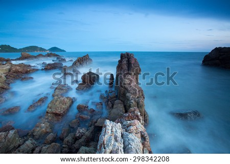 rocks in the sea covered of foam and fog under a blue sky, stone the exposure - stock photo