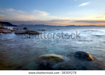 Rocks in the surf off the shore of Lake Tahoe at sunset