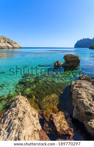 Rocks in water at beautiful bay of Cala San Vicente, Majorca island, Spain