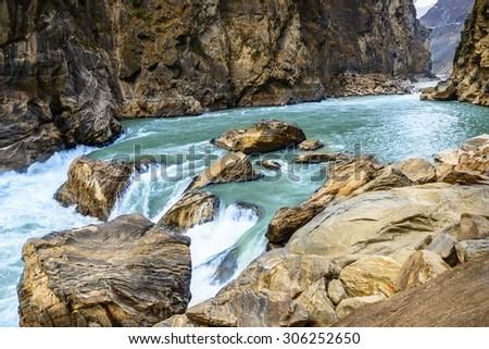 Rocks of Tiger Leaping Gorge. Located 60 kilometres north of Lijiang City, Yunnan Province, China. - stock photo