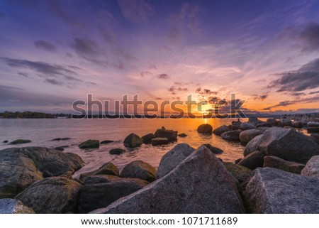 rocks on beach with sunset sky backgrounds.English bay Vancouver Canada