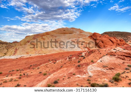 Rocks on fire at sunrise in scenic Valley of Fire State Park, Nevada - stock photo