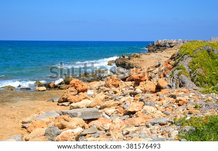 Rocks on the coast of Aegean Sea in Malia, Crete, Greece.
