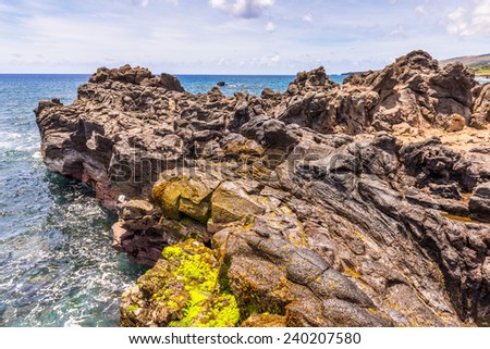 Rocks on the coast of the Pacific Ocean, Easter Island, Chile - stock photo