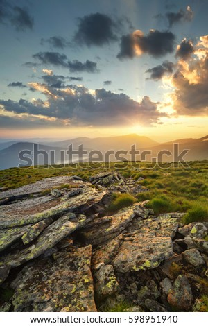 Rocks on the mountain field during sunrise. Beautiful natural landscape in the summer time