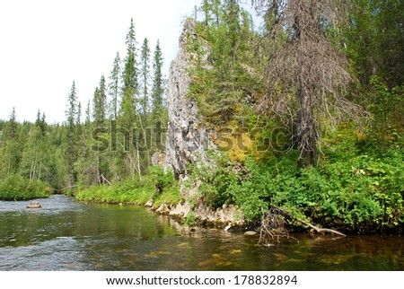 Rocks on the river Big Sarjuga. Virgin Komi forests, taiga in the Ridge Chernyshov.