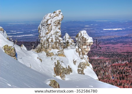 Rocks on the slope Otlichnogo grebene. Nature Park Taganay in the southern Urals.