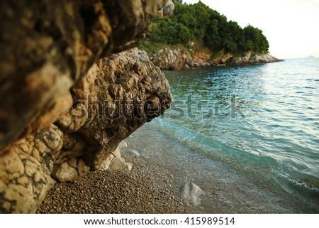 rocks, sand and the sea - stock photo