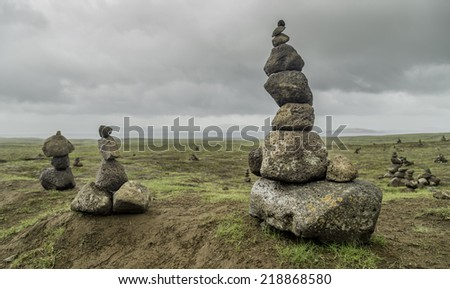Rocks stacked into towers in southwest Iceland - stock photo