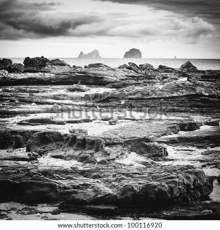 rocks under stormy sky, Andaman Shore, Thailand - stock photo