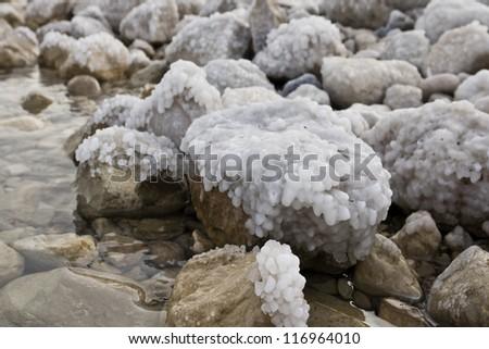 Rocks with salt sediment background - stock photo