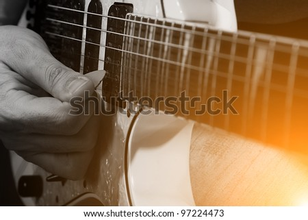 rockstar playing solo on guitar in black and yellow