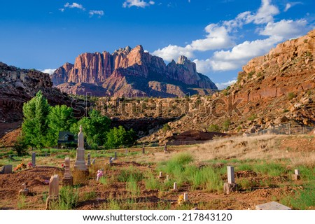 rockville cemetery in zion national park and mountains in the background - stock photo