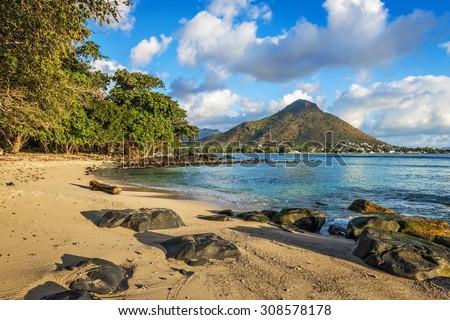 Rocky and sandy shore in Tamarin Bay, Wolmar, Flic en Flac, Mauritius Island, Indian Ocean - stock photo