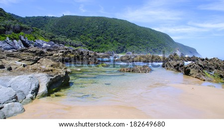 Rocky beach along the Otter Hiking Trail, South Africa - stock photo