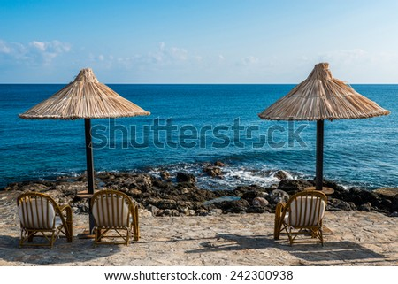 rocky beach at a luxury hotel in Crete, Greece - stock photo