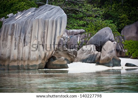 Rocky beach at Seychelles - vacation background - stock photo