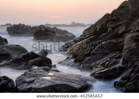 Rocky beach at sunset, north of Portugal. Long exposure.