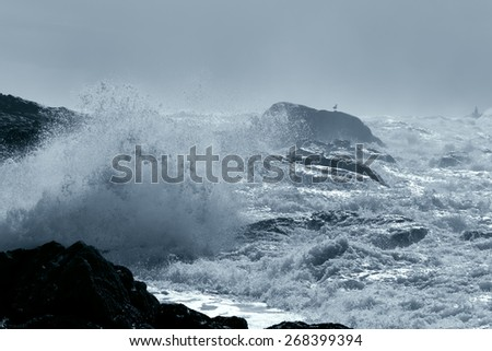Rocky beach from the north of Portugal during storm - stock photo