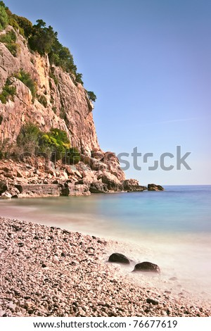 rocky beach high cliffs blue sky and sea Sardinia Italy sardegna tourism and travel beautiful majestic landscape