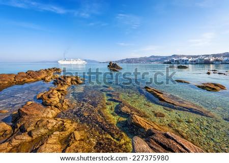 Rocky beach in front of Little Venice in Mykonos, Cyclades, Greece - stock photo