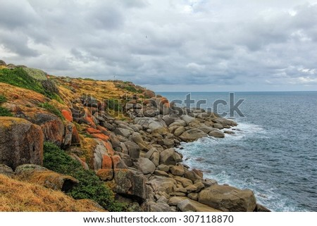Rocky beach in Granite Island off the coast of Victor Harbour South Australia - stock photo