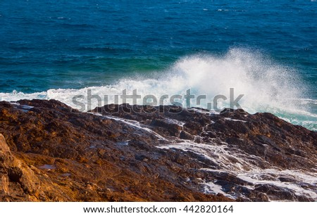 Rocky beach of the island of Mykonos. Greece. - stock photo