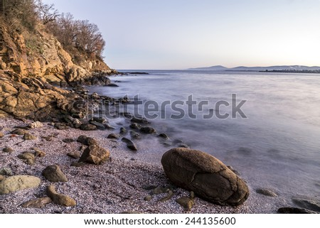 Rocky beach on black sea - stock photo