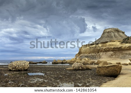 Rocky beach on stormy day