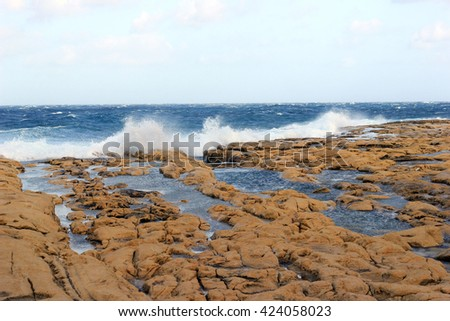 Rocky beach, seascape  waves hitting the shore