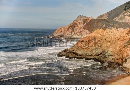 Rocky cliffs and coastline near Half Moon Bay, California - stock photo