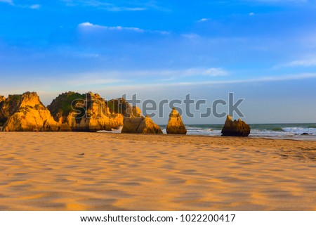 Rocky cliffs at Beach of the Three Brothers near Portimao, Portugal.