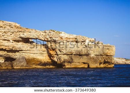 Rocky cliffs, the Black Sea coast. Cape Crocodile - Crimea, Cape Tarkhankut - stock photo