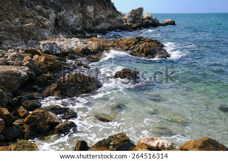 Rocky coast and waves of the sea - stock photo