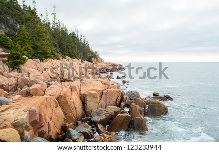 rocky coast at sunrise at Acadia National Park in Maine - stock photo
